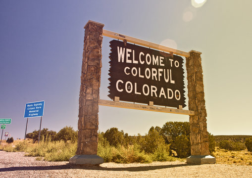 Colorado USA, Welcome sign on the state border, Instagram filter destaurated processing for vintage looks