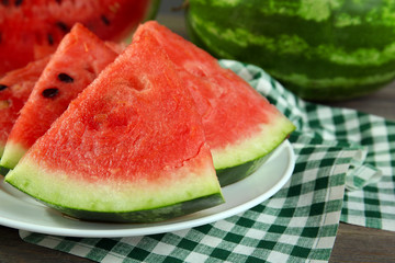 Slices of ripe watermelon on table close up