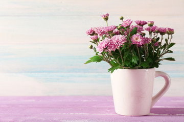 Beautiful purple chrysanthemum flowers on wooden background