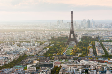 Paris skyline with the Eiffel tower and La Defense business district in the haze in the background, France