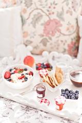 Breakfast in Bed. Cottage Cheese, coffee, berries, cookies and jam. Sweet morning.