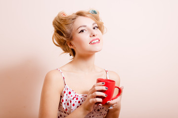 Housewife with red cup of hot drink