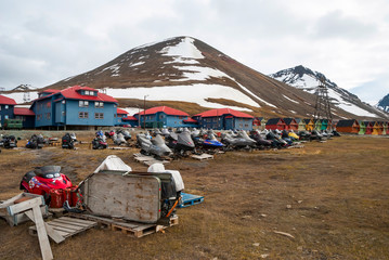 Acrylic Prints Arctic Snow mobiles parked infront of the houses in Longyearbyen