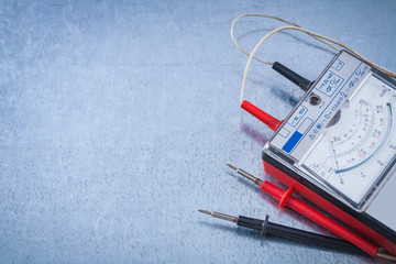 Fototapeta Electrician's instrument of measurement on scratched metallic ba obraz