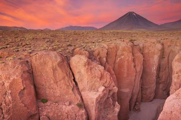 Canyon and Volcan Licancabur, Atacama Desert, Chile at sunset