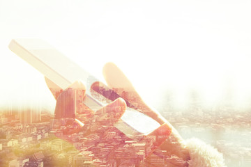 Using smart phone double exposure. Business technology concept.