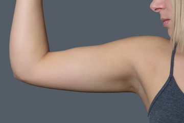 Athletic Young Woman Showing her Arm Muscle