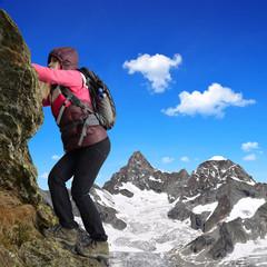 Girl climbing on the rock in Pennine Alps, Switzerland