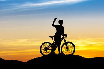 Women bike at hill mountain