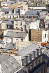 PARIS, FRANCE, on AUGUST 26, 2015. The top view from a survey platform on roofs of buildings in historical part of the city