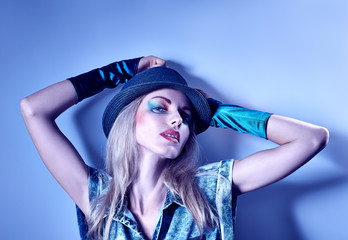 Beauty fashion sexy hipster woman, unusual creative look on blue