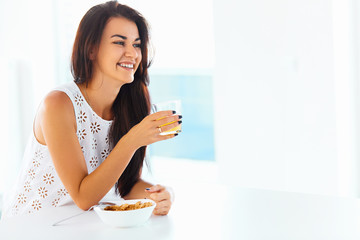 Portrait of woman enjoying her morning meal. Healthy eating. Hea
