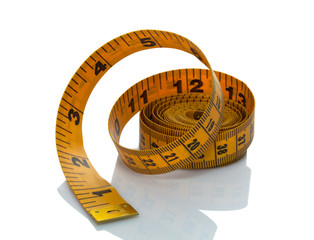 Rolled tape measure on white background