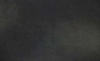 Closeup fabric at the black mouse pad background
