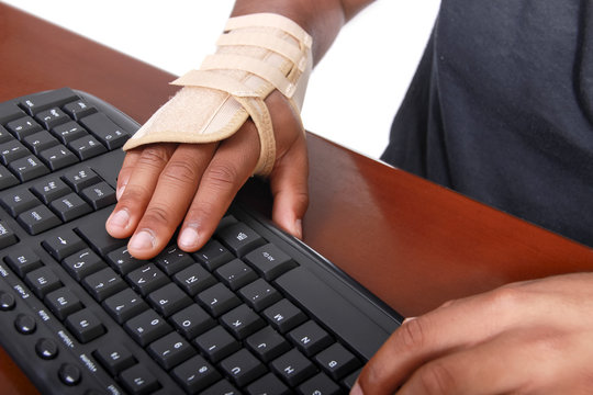 young man in a isolated background with carpal tunnel syndrome