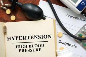 High blood pressure   hypertension  written on a book. Medical concept.