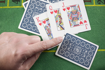 Finger pointing marked cards cheating. Poker