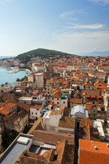 View of Split's historic Diocletian's Palace, old town and Marjan hill from above in Croatia.