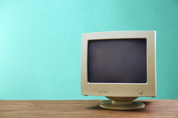 Obsolete computer set on light blue background Wall mural