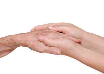 Young woman holding her grandmother hand over white background