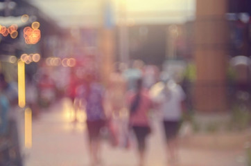 Blur people walking in shopping center mall abstract background.
