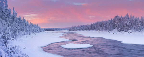 Wall Mural - Sunrise over a river in a winter landscape, Finnish Lapland
