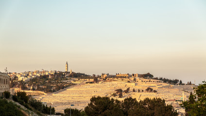 Panorama of Mount Olives with cemetery on sunset
