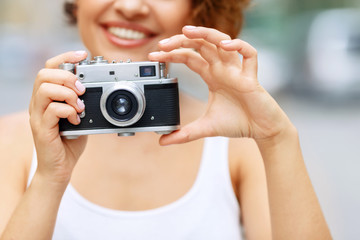 Smiling girl making photos