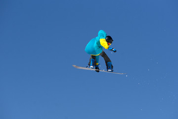 Poster Superheroes Snowboarder jumps in Snow Park