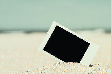 Retro Photo Of Blank Instant Photo Card On Beach Sand In Summer