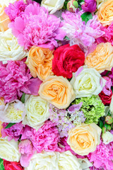 floral arrangement of colorful peonies and roses for event or wedding celebration