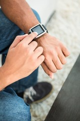 High angle view of man using smart watch