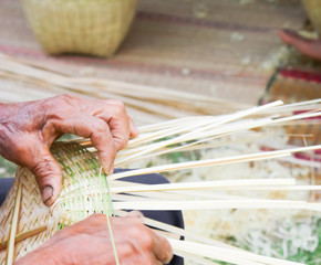 People are demonstrating weaving baskets made from bamboo