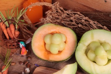 Cantaloupe melon fruit juicy on wood background.