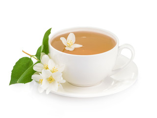 Cup of green tea with jasmine flowers isolated on white backgrou