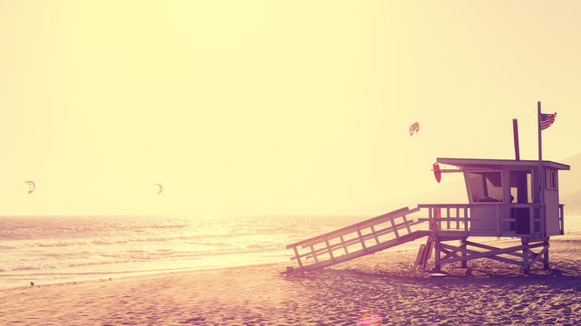 Vintage style picture of lifeguard tower at sunset in Malibu, California, USA.