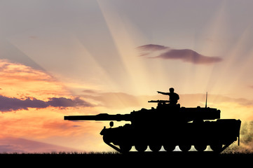 Silhouette of a tank with a soldier