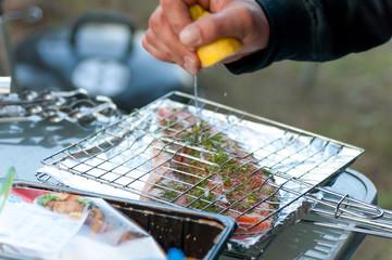 fish fillet of salmon sprinkled with lemon juice
