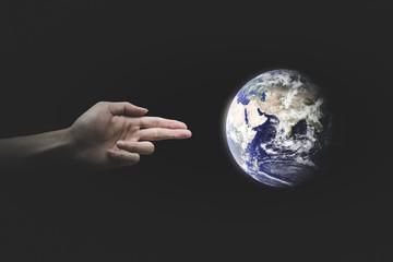 Human Hand Shooting the World. Environment concept. World Environment Day concept. - Elements of this image furnished by NASA.