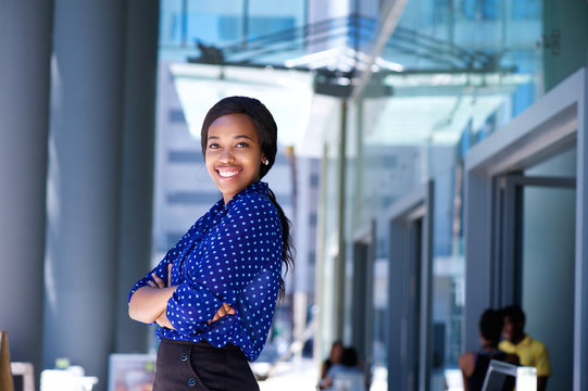 Smiling african business woman with arms crossed