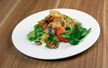 Salad with fried onions, potatoes