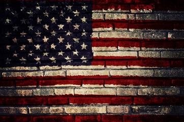 Flag of United States of America painted on dirty brick wall