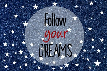 Follow your dreams motivational message over blue glitter background