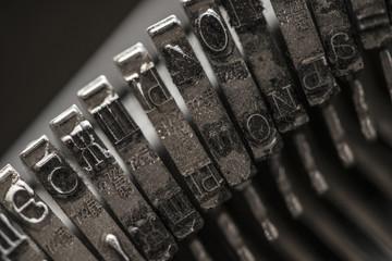 Metal letters on typewriter