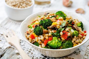 barley porridge with corn, broccoli, garlic, mushrooms and peppe