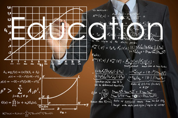 businessman writing education concept and drawing some diagrams