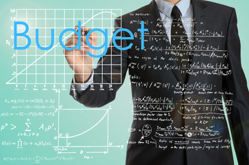 businessman writing Budget and drawing graphs and diagrams