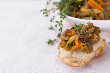 Vegetable ragout of eggplant, zucchini and carrots on slice of homemade bread