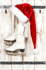 Christmas decoration. Red Santa Claus hat and ice skates