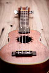 ukulele on wood background